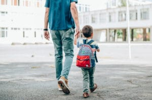 Father and son going to school.