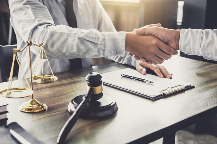person meeting divorce attorney